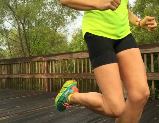 Running in HOKA One One Maximal cushion shoes